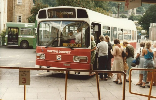 Passengers board a Wilts and Dorset Leyland National at Bath in 1984