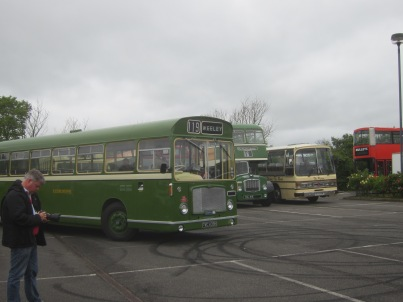 A preserved Eastern National Bristol RE in 'Tilling' livery moves forward to pick up passengers for one of the free bus trips into town.