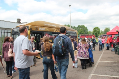 The crowds pass 'The Leopard' as they make their way into the depot.
